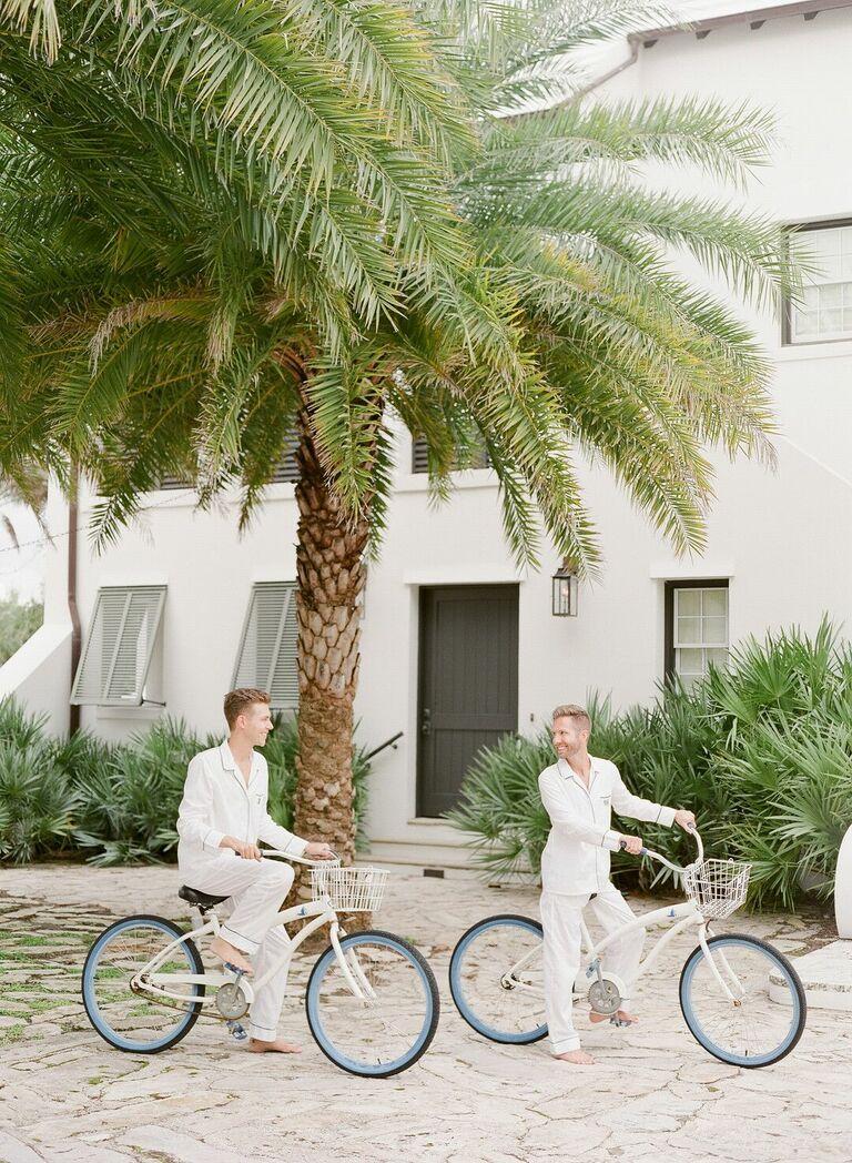 Couple riding beach cruisers in matching pajamas