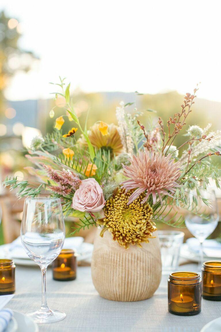 Chrysanthemum floral arrangement in clay vessel