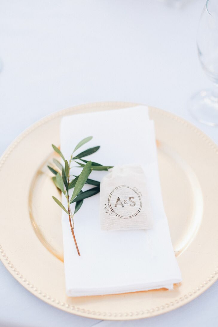 """The couple created personalized cocktail napkins with """"Fun Facts"""" about them as a couple, including where they went on their first date, some of their unusual talents, and their first dance song. For favors, they stamped small bags with a custom rubber stamp and filled them with one of Adria's favorite childhood treats, Utah Truffles, as well as recommendations for their visit to St. George."""
