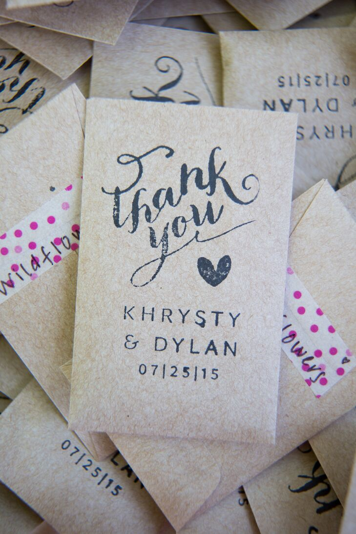DIY favors had an extra personal touch: the couple filled seed packets with wildflower, stamped a custom design on the front, and secured the back with decorative tape.