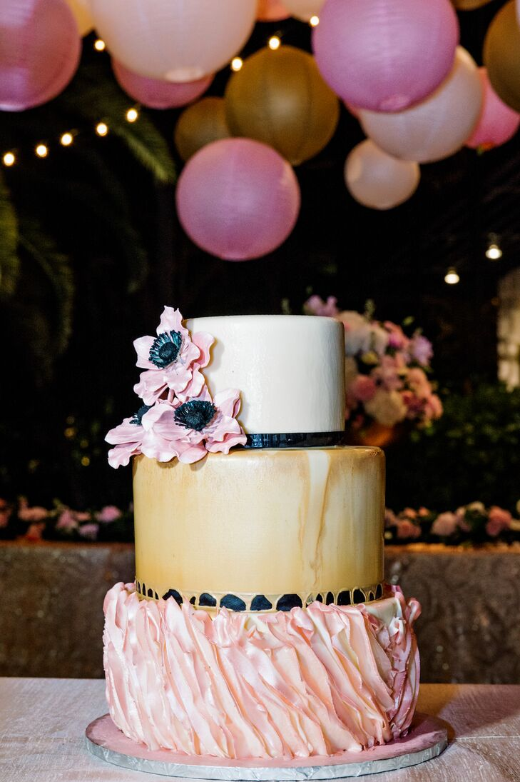 Lona and Bryan enjoyed a three-tier fondant cake with a pale pink leaf-textured bottom layer, an antique gold middle layer and an ivory top layer with pink anemone sugar flowers. The couple also had an extra sheet cake to be sure they had enough for everyone.