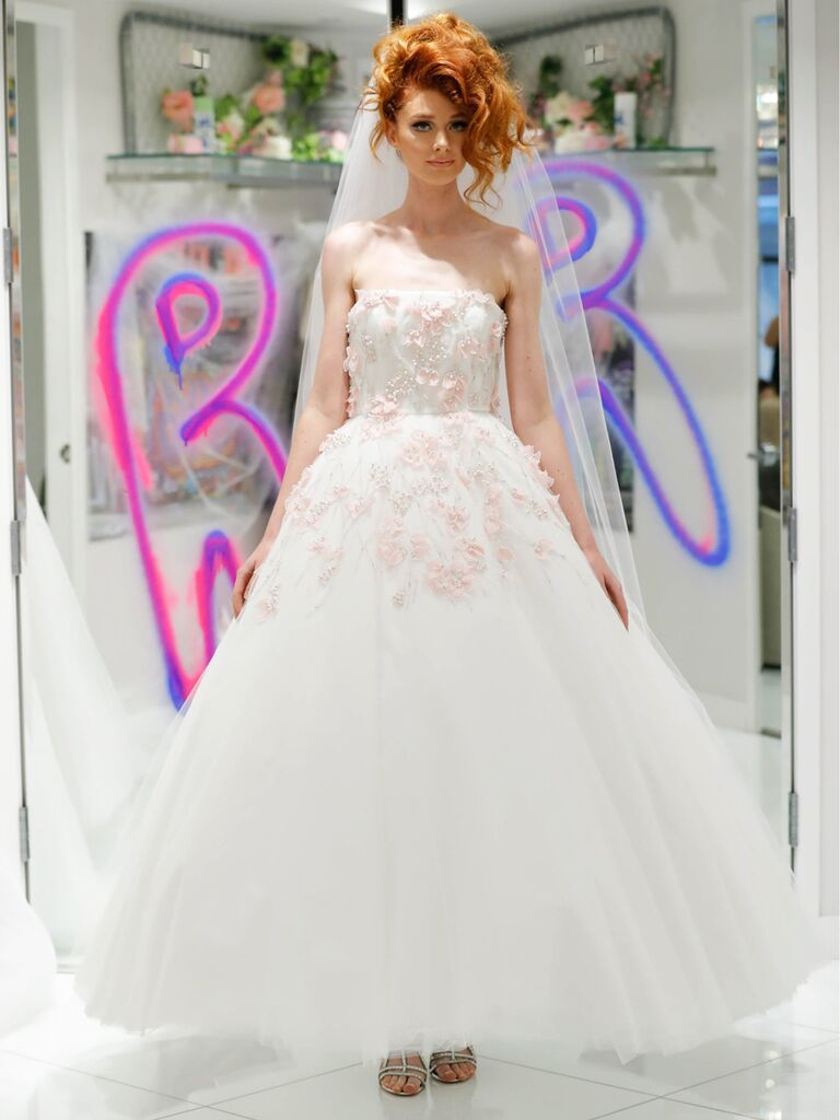 Randi Rahm Fall 2019 Bridal Fashion Week Collection strapless full A-line wedding dress with pink floral appliqué