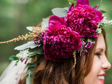 Maroon peony flower crown with a short hairstyle and veil