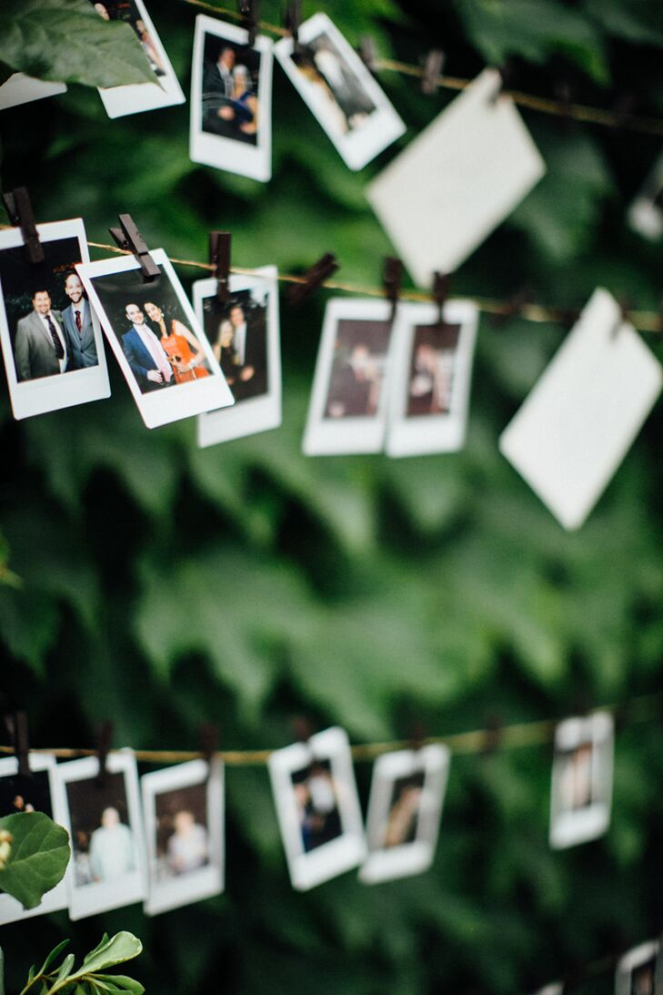 In the outdoor garden at Galleria Marchetti in Chicago, Illinois, a freestanding structure of curly willow accented with tufts of floral and seeded eucalyptus, mock orange and jasmine held the escort cards, attached with wooden clothespins. Guests were then invited to replace their escort card with a fun Polaroid picture.