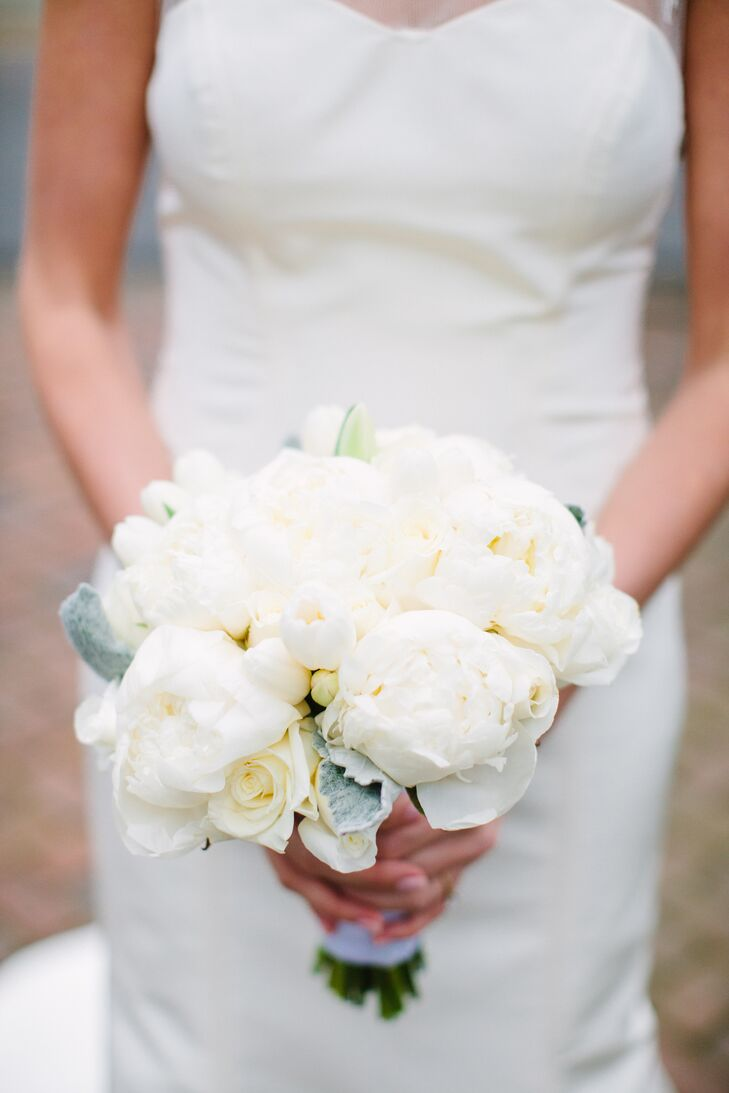 Emery carried an all-white bouquet including peonies, roses, tulips and dusty miller. She loved the classic look and how it fit in with the natural winter wedding.