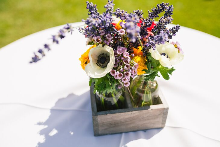 Lush flower arrangements of ivory anemones and lavender were arranged inside a rustic wood box and served as a table centerpiece.