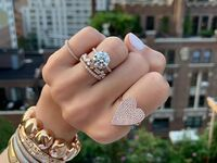 Engagement ring and stacking rings on hand