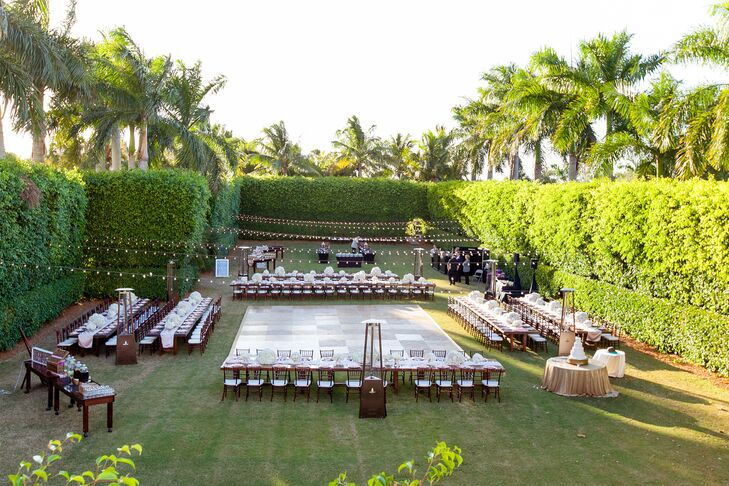 """The Hyatt Regency Coconut Point Resort and Spa's courtyard Bonita Springs, Florida, had plenty of room to execute a gorgeous reception—and Lauren had specific plans on how to fill it. """"I knew exactly what I wanted and did not want to veer away from my vision,"""" Lauren says. """"From the centerpieces to the linens to the lighting and beyond, every detail was carefully thought-out."""" Lines of cherrywood tables and white linens circled a matching dance floor of neutral tones so every piece of the design seamlessly fit into one another."""