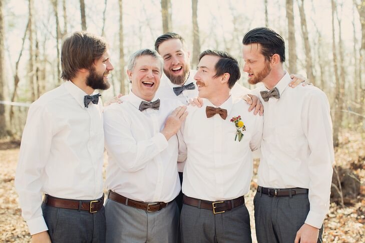 The groomsmen kept their looks casual in crisp white shirts and mismatched wool bow ties.
