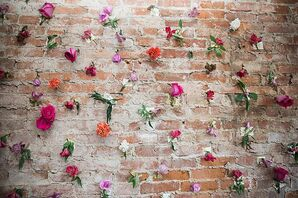 Brick-Wall Backdrop Decorated With Flowers