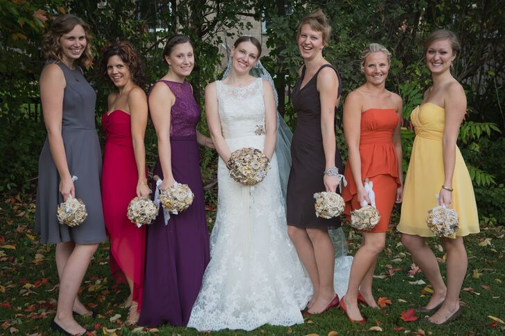 Erin-Joy let her bridesmaids pick their own dresses under one condition: She got to pick the color. The result was a fabulous array of fall-colored dresses, adding a pop of color to the wedding party.