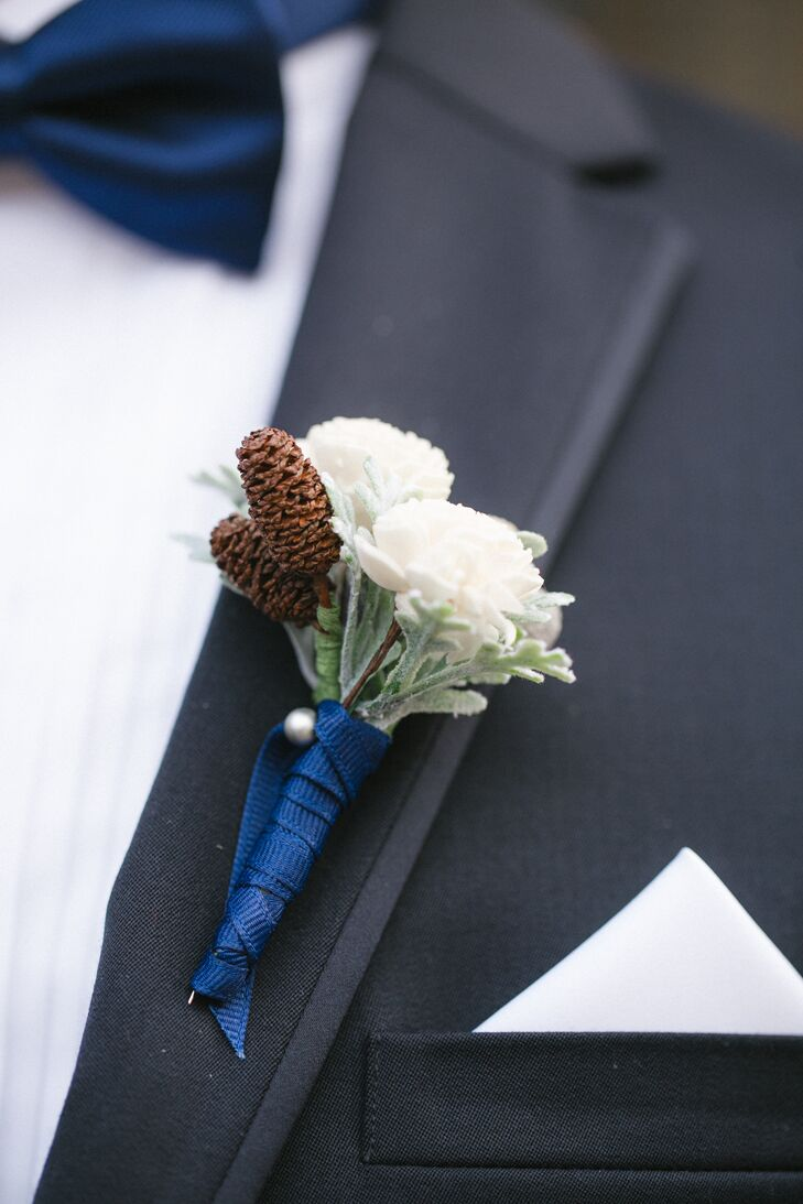 Matthew and his fellow Air Force offers donned traditional Air Force mess dress for the wedding, while his non-officer groomsmen sported traditional navy suits. They accessorized the Michael Kors suits with navy bow ties, crisp white pocket squares and rose and pinecone boutonnieres that complemented the wedding's elegant, wintry theme.