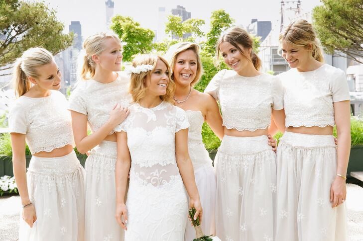 """""""I fell in love with a Emillo Pucci runway look almost a year ago, and decided I wanted the bridesmaids to look sexy, trendy and in that style,"""" Sasha says of the inspiration for her two-piece, crop top bridesmaid dresses. The beige dresses with a delicate floral pattern were custom made by a Parsons student."""