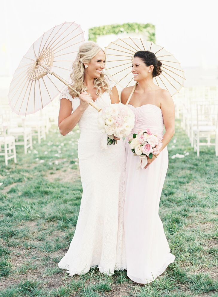 """Bridesmaids donned strapless floor-length Donna Morgan dresses in """"petal"""" pink and carried an ivory and pink bouquet of roses, dahlias and hydrangeas."""