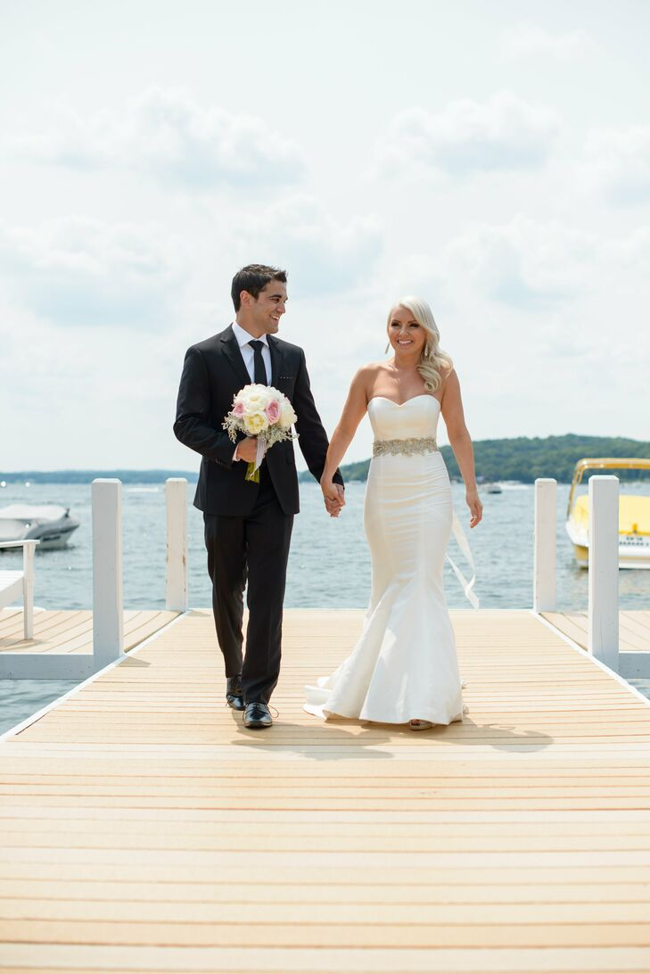 "The newlyweds have always loved summertime trips to Lake Geneva and hoped their guests would equally enjoy their weekend there. ""We had our rehearsal dinner on a boat the night before, our ceremony outdoors and reception on the lake,"" says Clare. ""Everyone loved being outside enjoying the beautiful weather and being on the lake!"""