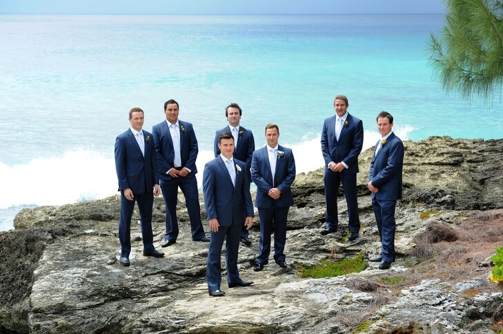 The scenic, historic venue overlooked the amazing turquoise sea that surrounds the Cayman Islands. Groomsmen posed on the rocky cliffs overlooking the stunning views.