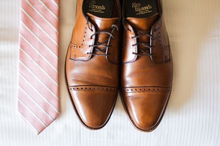 The groom accessorized his black suit with Allen Edmonds leather shoes and a striped salmon tie.