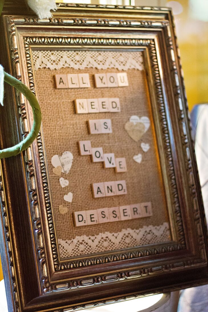 """The sign for the dessert table read """"All you need is love and dessert"""" in Scrabble tiles."""