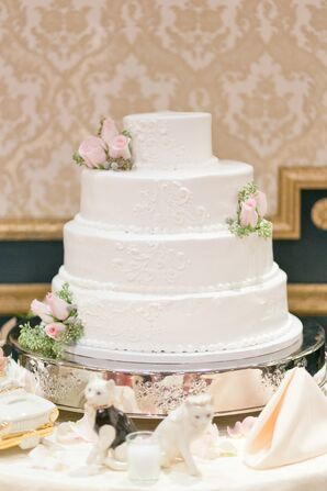 White Wedding Cake With Roses and Eucalyptus