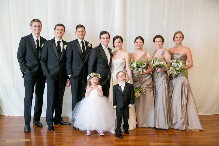 Chelsea and Chris stood in the middle of their wedding party, dressed in a combination of neutral colors. The bridesmaids wore floor-length dresses in different necklines, which they picked to best suit their personality and style. The groomsmen matched Chris and wore black tuxedos paired with black ties.