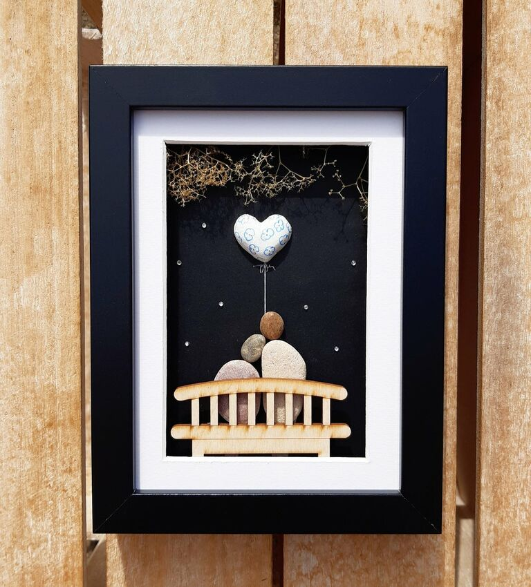 Framed multimedia art with couples made out of pebbles and china heart balloon