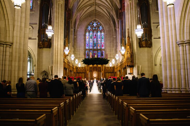 Kara and Pat exchanged vows at Duke Chapel in Durham, North Carolina, for a traditional ceremony. They loved the towering ceilings, Gothic chandeliers and stunning stained glass. Since the space was naturally gorgeous, they kept their decor to a minimum.