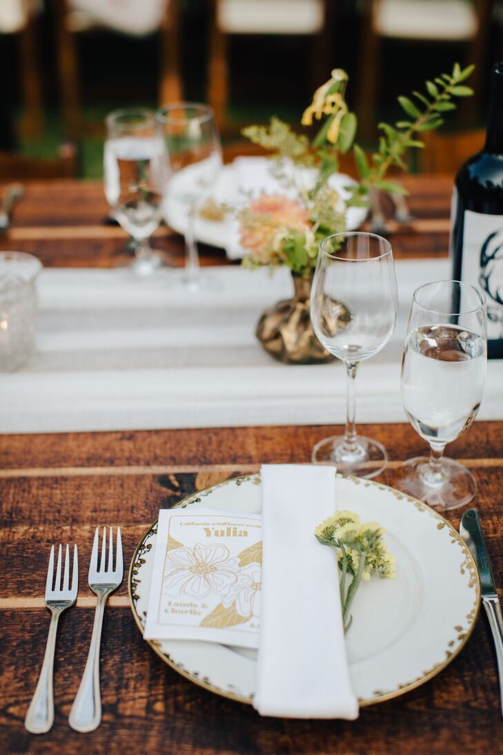 Rustic Place Setting with White Chargers and Wildflowers