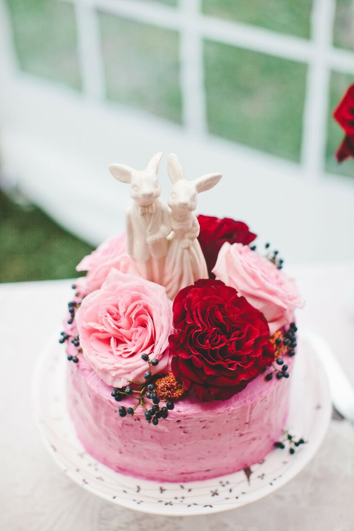 The couple served cupcakes to guests, but cut into a vegan, beet-based cake with sweet beet frosting and topped with a custom ceramic topper.