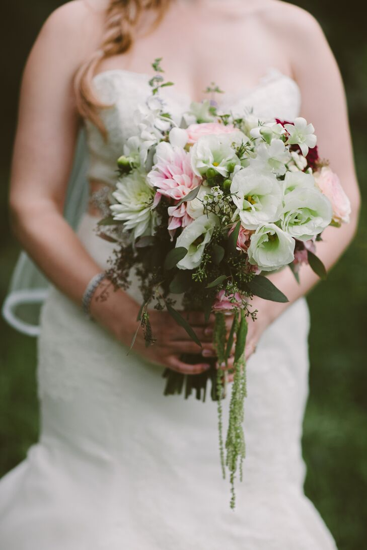 Mary carried a soft bouquet of pink and white dahlias, white lisianthus, seeded eucalyptus and amaranthus.