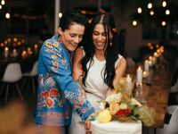 Couple cutting the cake at wedding reception