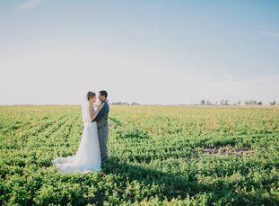 Thanks to a neutral palette and a mix of vintage and rustic decor, this shabby-chic backyard wedding in Brawley, California, embodied a cozy feel for