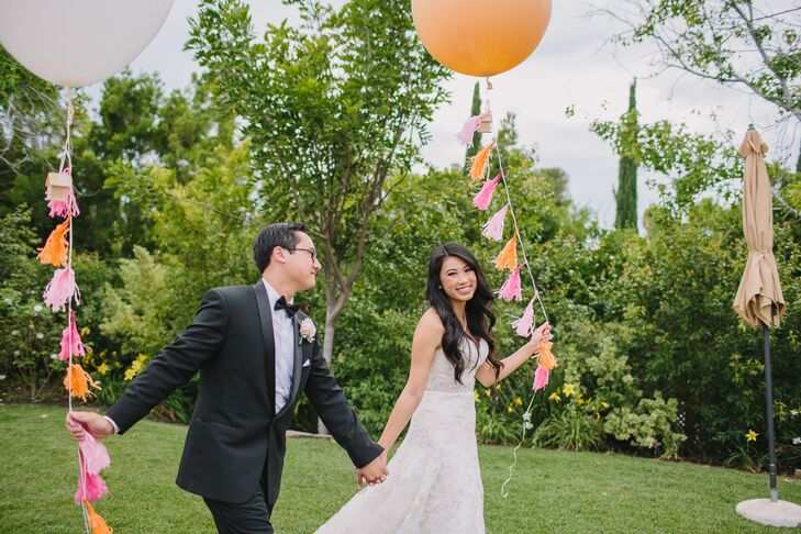 """Nancy decorated the entrance to her reception with giant gold balloons spelling """"love."""""""