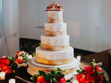 white and gold tiered wedding cake