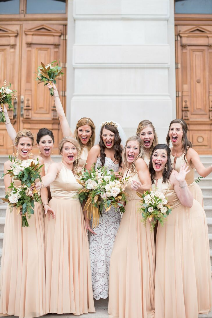 "The bridesmaids, Sarah's ""golden goddesses,"" wore floor-length gold dresses with satin on top and chiffon on the bottom."