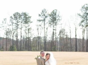 Emily and Preston exchanged vows in an elegant celebration with a color palette of neutral earth tones and festive floral arrangements in Cullman, AL.