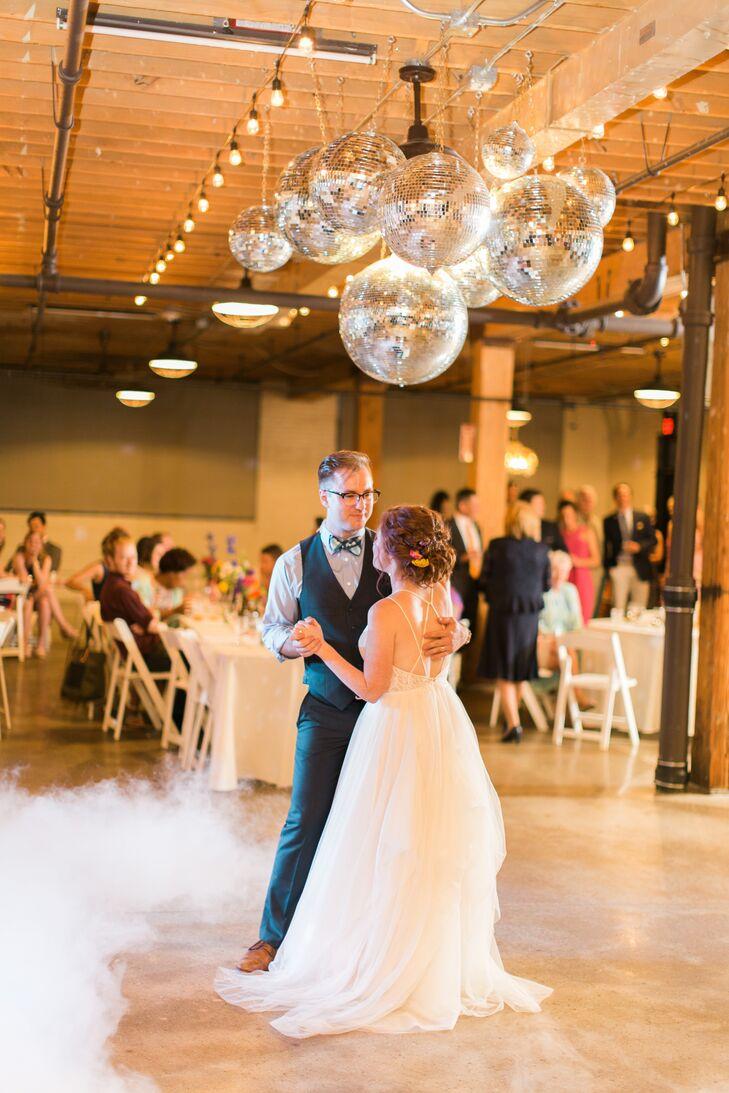 Couple Dancing Under Disco Ball Chandelier
