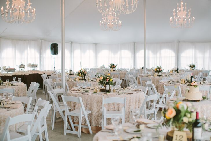 Ivory chandeliers, lace table linens and gilded accents filled the reception tent with an air of old world charm and warmth.