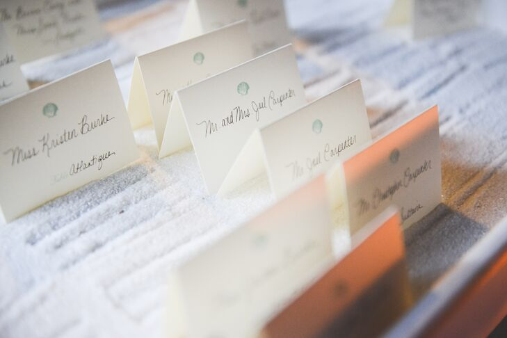 The tented escort cards were printed on white ecru paper with an small aqua seashell.