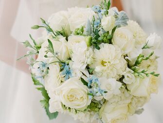 """Stumped on picking a """"something blue?"""" Consider choosing flowers in a blue hue for a pretty bouquet that's also a nod to this tradition."""