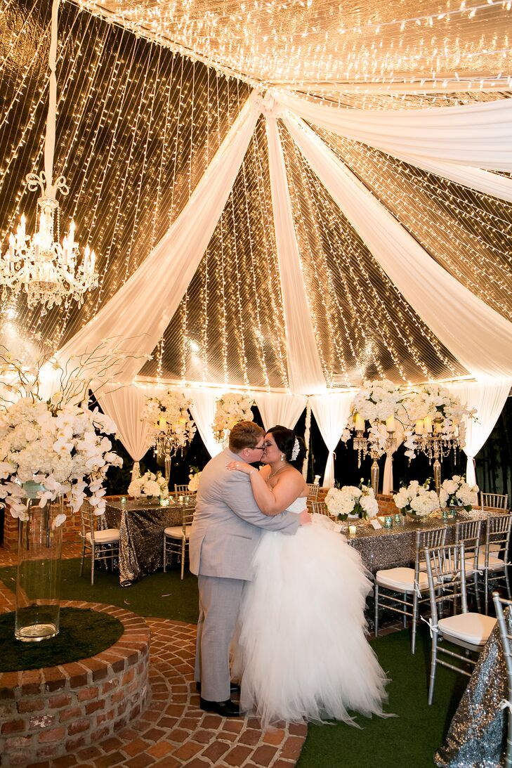 Brides at Glamorous Tented Reception with String Lights