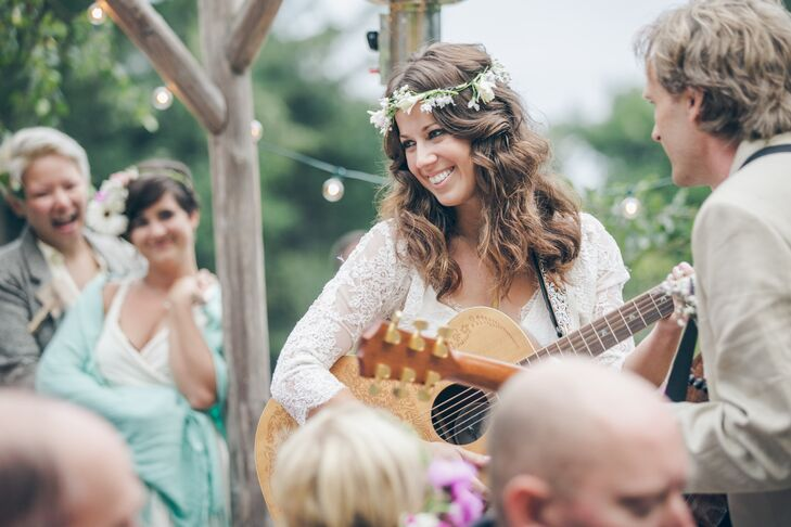 Jayme and Jeremy performed a song on their acoustic guitars during their reception entrance, showing their love for music, which brought them together.