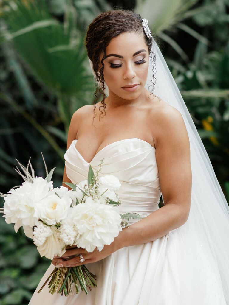 wedding updos low bun with sparkly hair piece