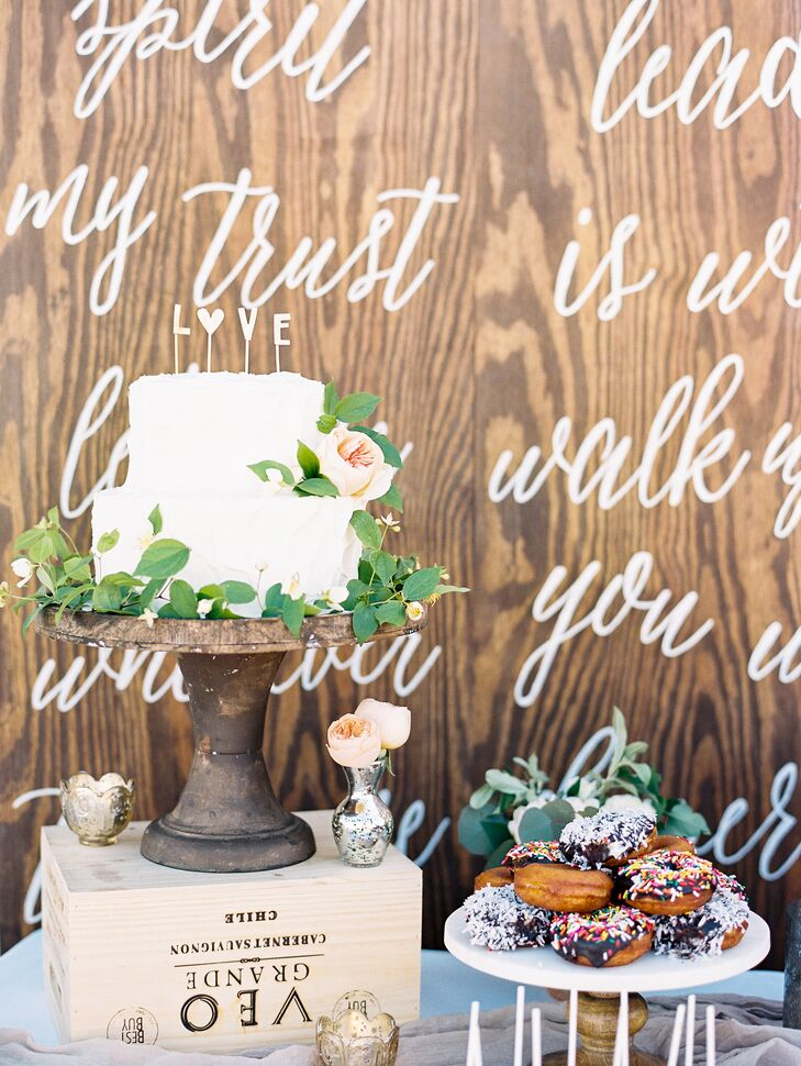 """As a backdrop to the dessert table, Taylor created a large board out of plywood. She stinted it a dark coffee color and calligraphed the lyrics of """"Oceans"""" by Hillsong United (her processional song) onto it."""