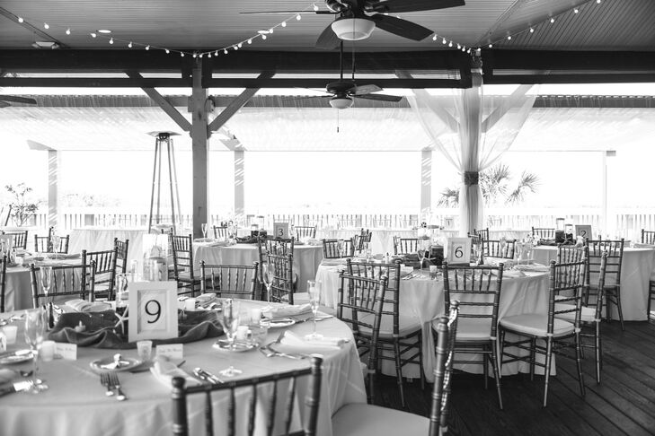 After the ceremony, guests walked over to the open-air terrace at the Omni Oceanfront Hotel for dinner and dancing. The room was just as Bethany and Ali had planned: There were twinkling string lights, draping, chiavari ballroom chairs and low, beach-themed centerpieces made up of candles and starfish and simple table numbers with white frames.