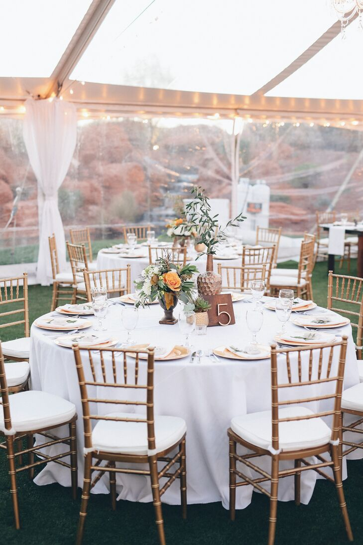 The color scheme included slate grey and navy as well as dark woods. Contrast and color was added with metallics and greenery. The couple's wedding planner had access to their Pinterest board, with creative liberty to make the most of the decor.