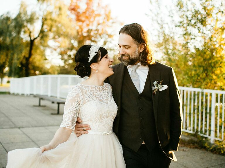 Groom with bride wearing vintage lace and tulle wedding dress