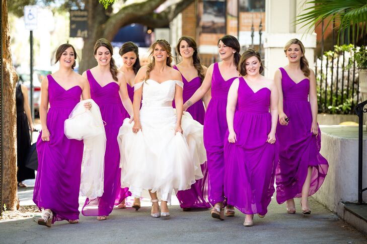 Amber's bridesmaids wore floor-length bridesmaid dresses from David's Bridal in Amber's favorite color: fuchsia. Their dresses featured sweetheart necklines with one shoulder straps -- a look that perfectly complemented Amber's sweetheart neckline and off-shoulder cap sleeves. The eye-catching color of their dresses spoke for itself, so they went with minimal accessories.