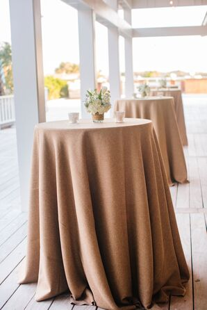 Simple White Centerpieces on Sandy Linens