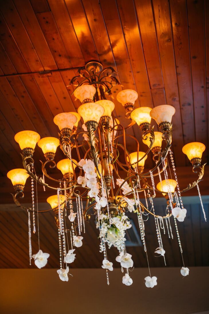 Strings of pearls and white orchids were hung off the antique chandelier in the middle of the reception room.