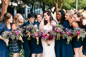 Wedding Party in Navy Dresses with Purple Bouquets